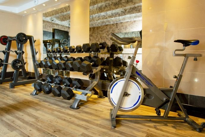 Free weights and training equipment in the Hostel Gym, Nice, France