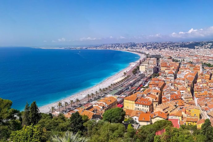 A view of Nice beach and the old town from above, Azure sea and colourful buildings, top 10 beaches in France