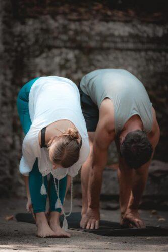 A couple enjoying an outdoor yoga class in Côte d'Azure