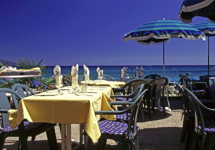 Table and chairs in front of the beach at Antibes, Riviera Holidays