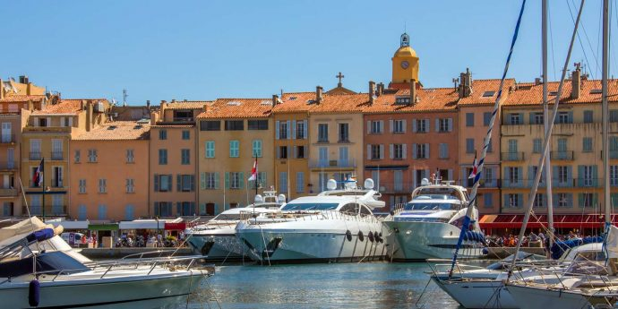 The pretty port at St. Tropez with colourful buildings and boats, on the boat trip from Nice to St. Tropez