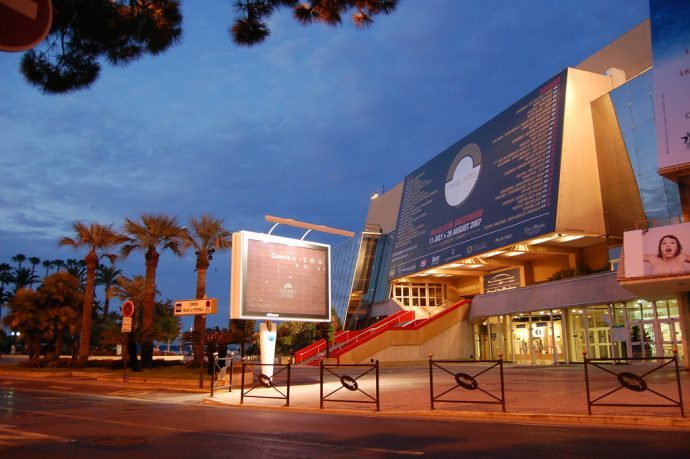 The outside of the Palais des Festivals in Cannes with it's red carpet in the Evening
