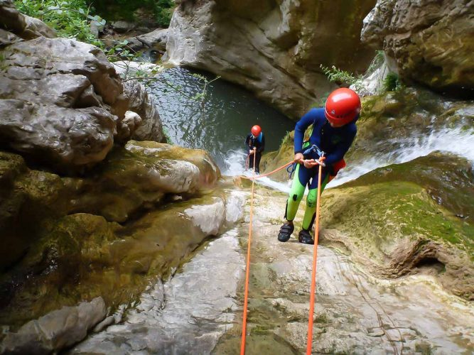 People abseiling and Canyoning in the south of France