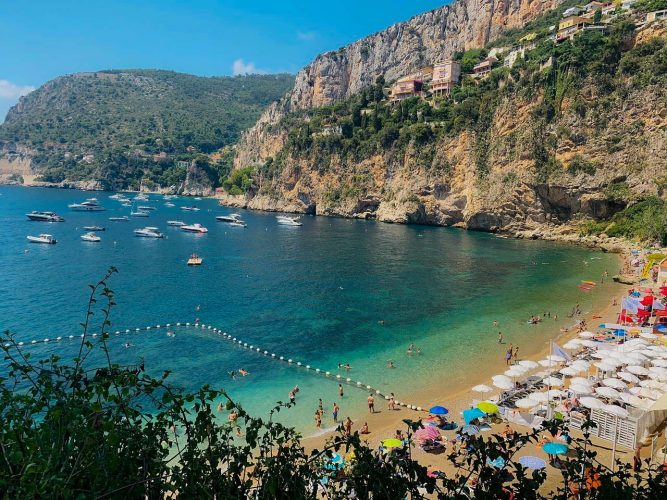 The pretty beach at Cap d'Ail beach with clear Azure sea, 10 ten beaches on the French Riviera