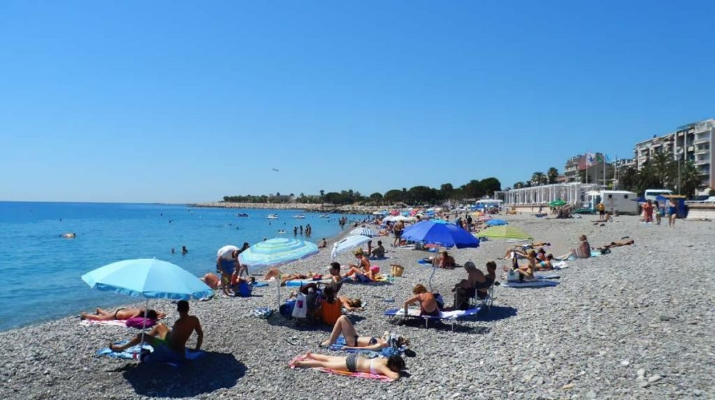 People relaxing on a lovely beach in Nice, France with disabled facilities.