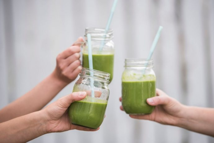 3 green smoothies in jars with straws at Villa Hostels