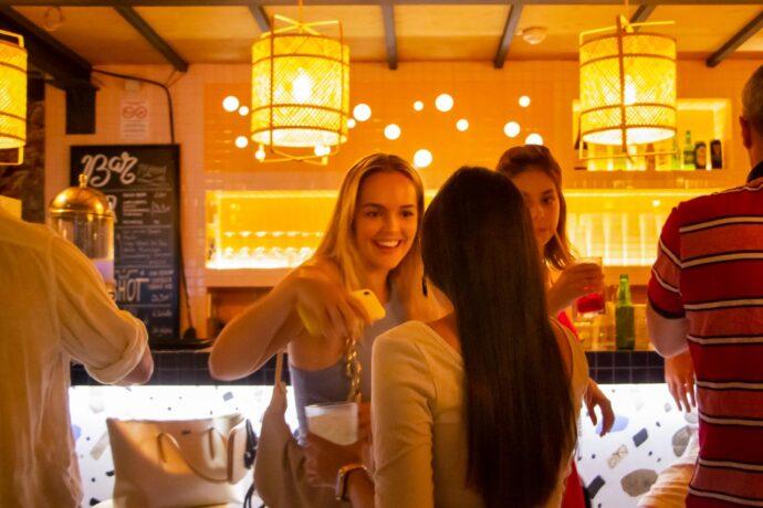 Girls enjoying cocktails at the bar, Villahostels, Nice, France