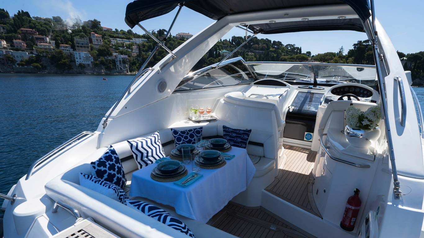 A Sunseeker Portafino set for lunch on the french riviera, Villa Hostels Day Trips