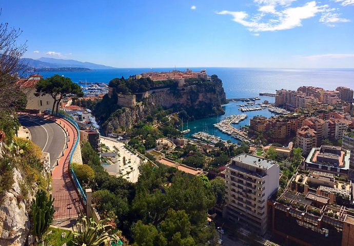 A view over Monaco showing the old town, the port and the modern city on a beautiful sunny day