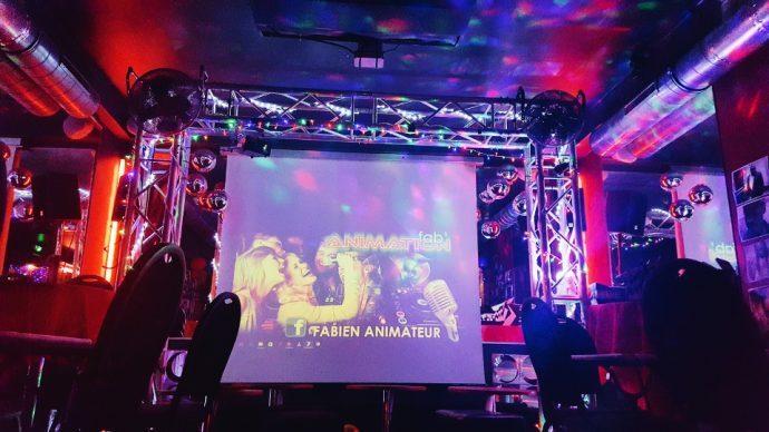 Karaoke screen at Le swing club, colourful night life in Nice, France