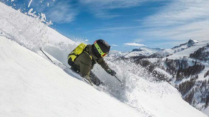 A downhill skier off piste on the slopes at Auron, southern France