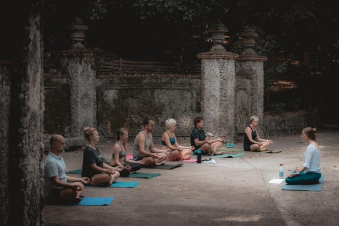 A group of people seated on Yoga mats in Nice, France