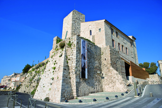 The old stone fortress building of the Picasso museum in Antibes on a bright sunny day