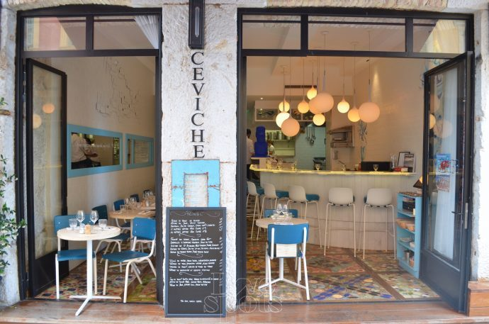 The open doors and Ceviche sign of the Rustic Peixe restaurant in Nice, France