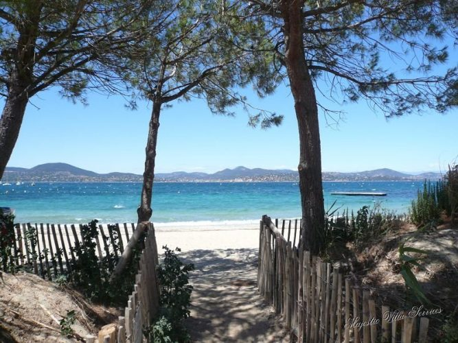 Trees and wooden fenced pathway to the beach at Saint Tropez, top beaches in France