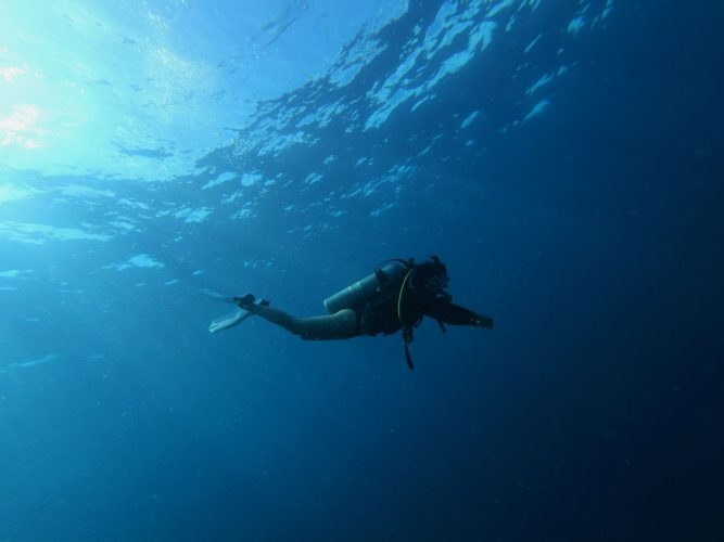 A scuba diver in the blue ocean, diving trips on the French Riviera