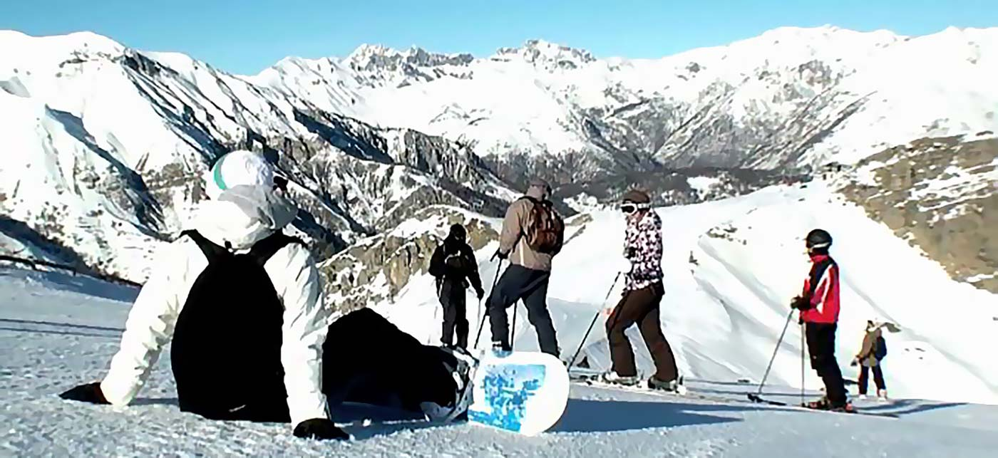 A groups of people with ski's and snowboards at the top of a mountain range