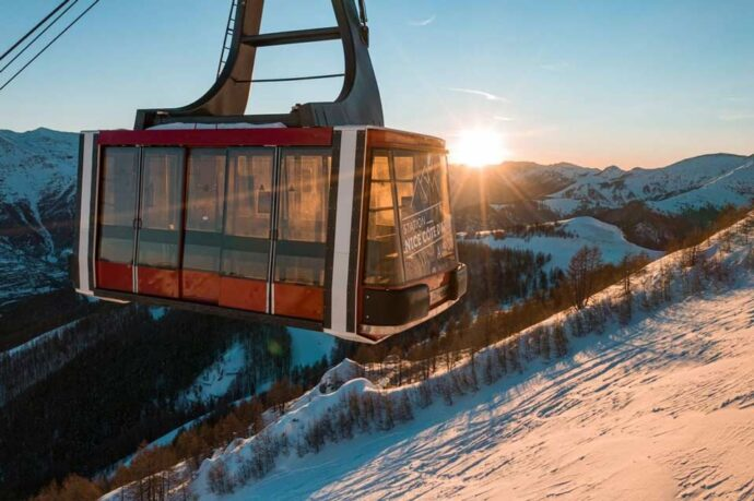A ski lift at sunset agains the mountain at Auron, Ski the French Alps