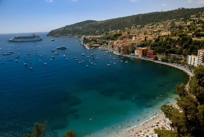 A view of Villefranche beach from above, with the town along the coast