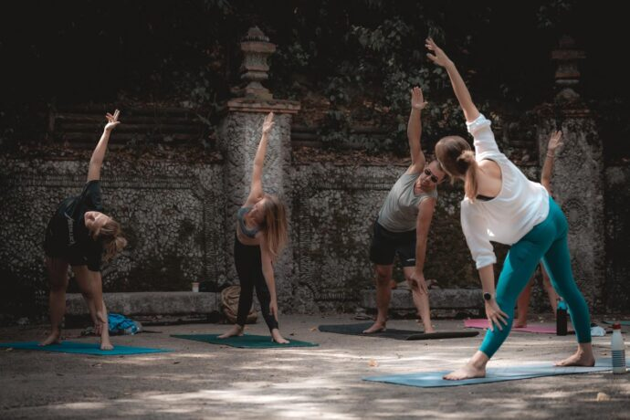 A group stretching doing outdoor yoga classes in Nice, France